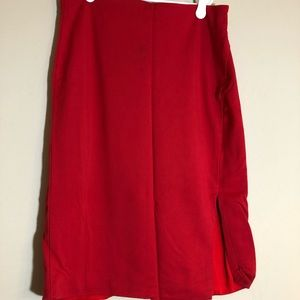 Red pencil skirt with slit.